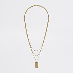 Goldfarbene Halskette im Lagenlook mit Blechschild und Kette