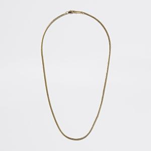 Goldfarbene Halskette mit Schlange und Kette