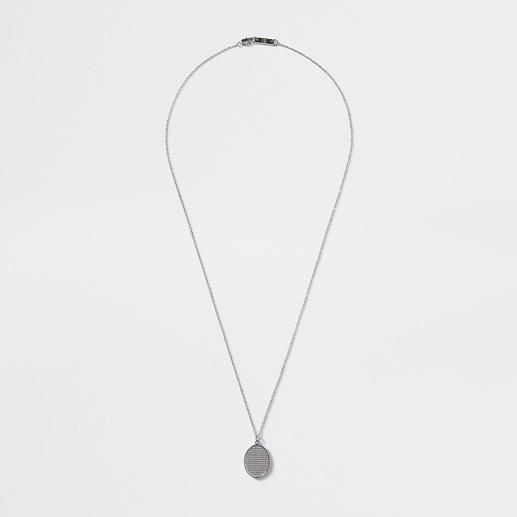 Silver colour textured oval pendant necklace
