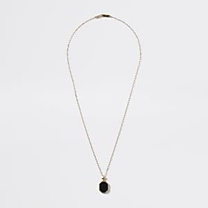 Goldfarbene Halskette mit schwarzem Emaille-Anhänger