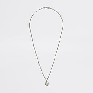 Silberfarbene Halskette mit religiösem Anhänger