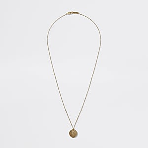 Goldfarbene Halskette mit Münzanhänger