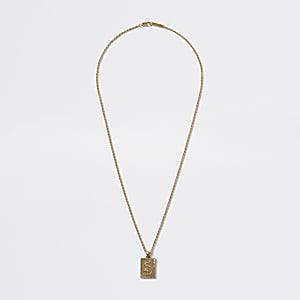 Goldfarbene Halskette mit Anhänger mit Drachenprägung