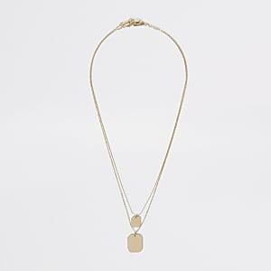 Goldfarbene Halskette im Lagenlook mit Schildchen
