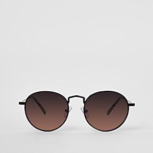 Zwarte ronde zonnebril met oranje glazen