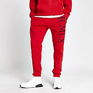 Pantalons de jogging slim rouges avec broderie MCMLX