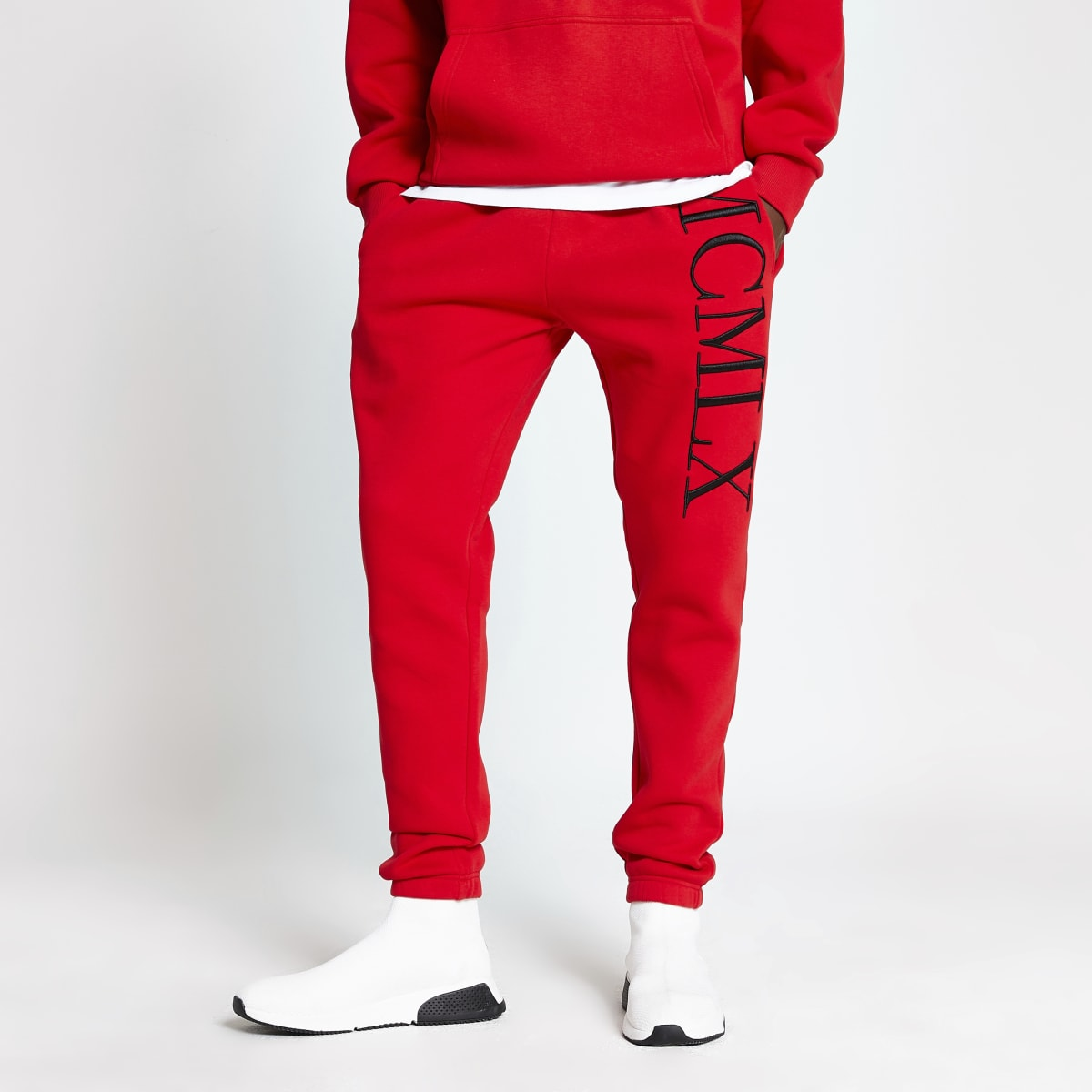 Red 'MCMLX' embroidered slim fit joggers