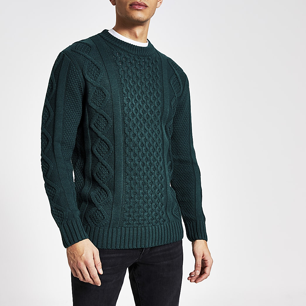 Dark green cable knit crew neck jumper
