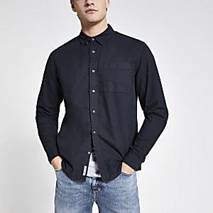 Marineblauw overhemd met lange mouwen en borstzakje