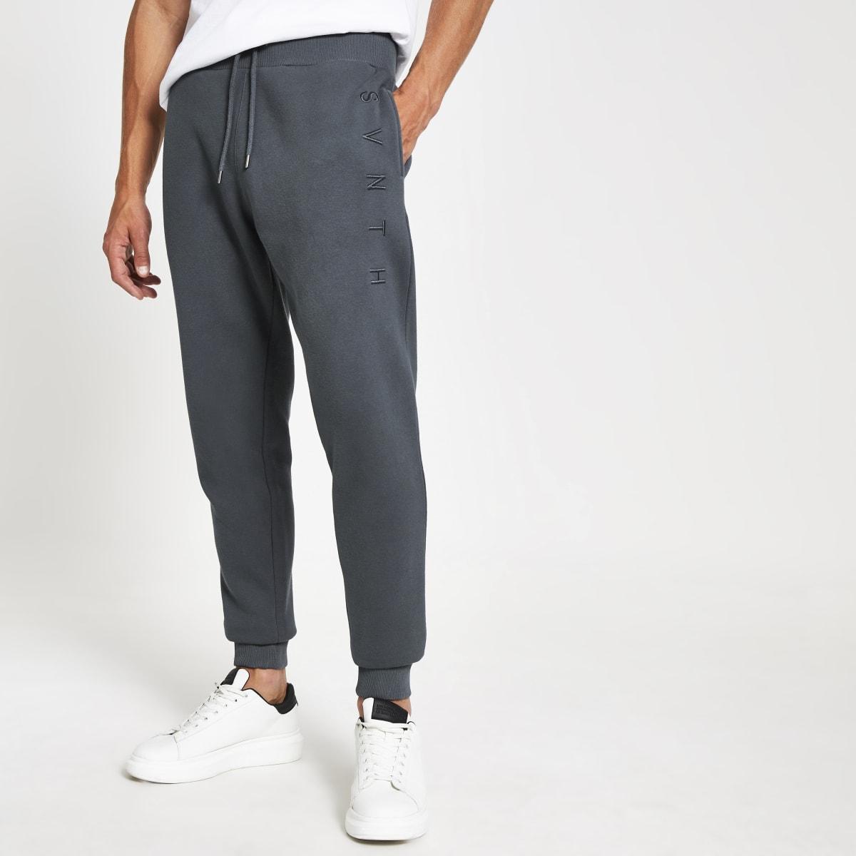 Pantalons de jogging bleu foncé à broderie Svnth