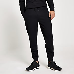 Maison Riviera – Schwarze Slim Fit Jogginghosen im Rippenstrick mit Streifen