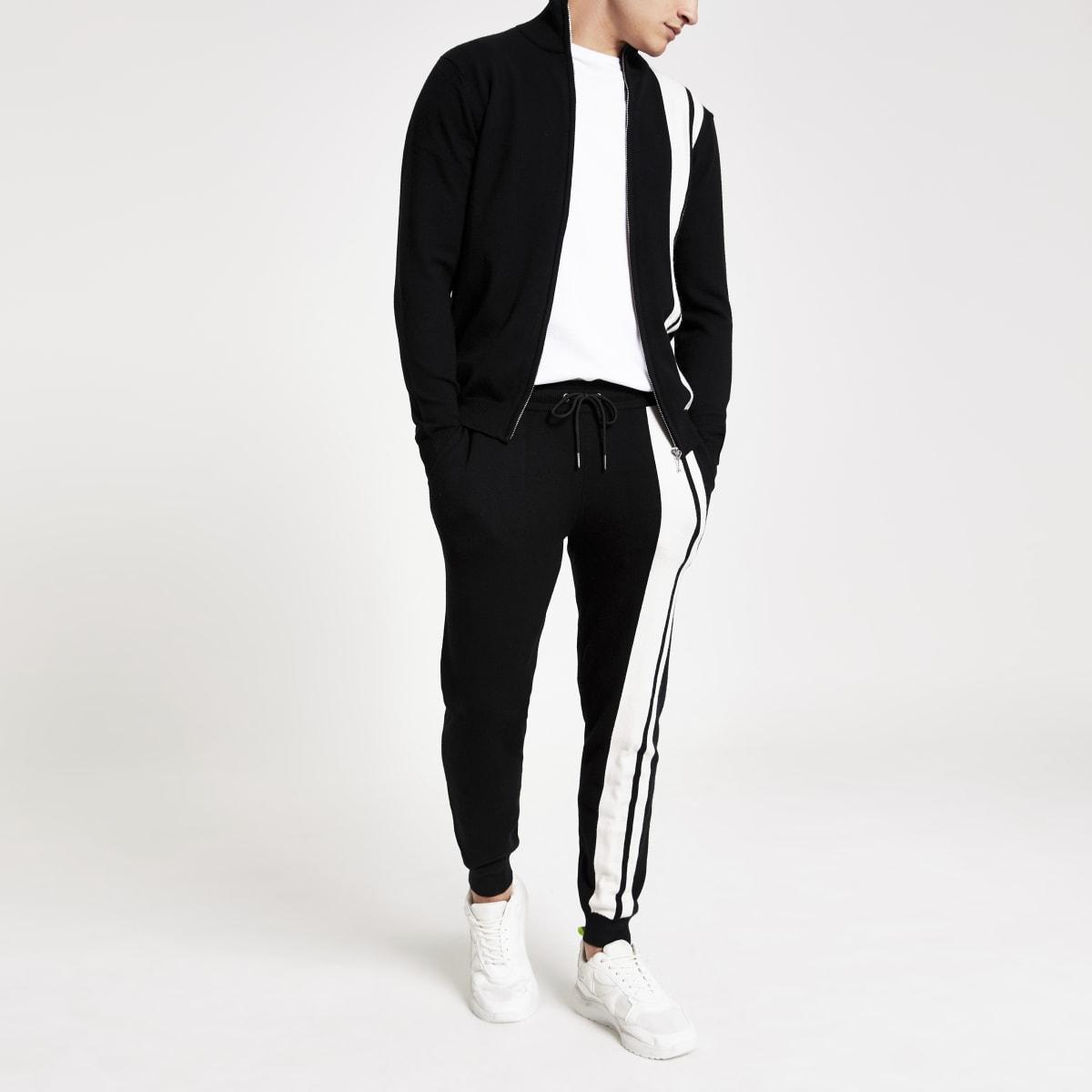 Figurbetonte, gestrickte Jogginghose mit Streifen in Schwarz