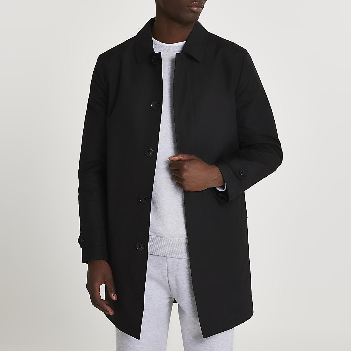 Zwarte overjas met verborgen knopen voor