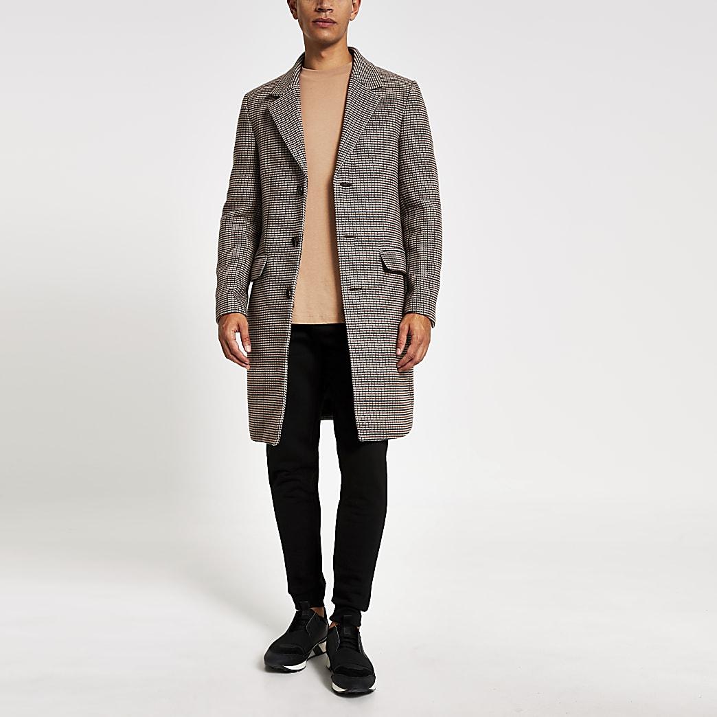 Bruine geruite lange overjas