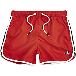 Boys red runner swim trunks