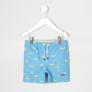 Mini boys blue shark print swim trunks
