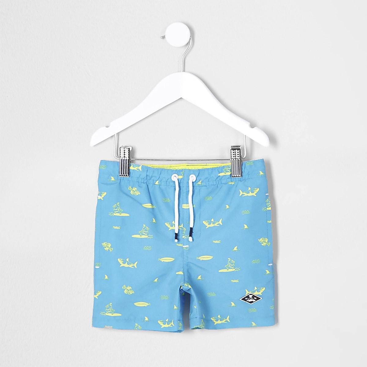 Mini boys blue shark print swim trunks
