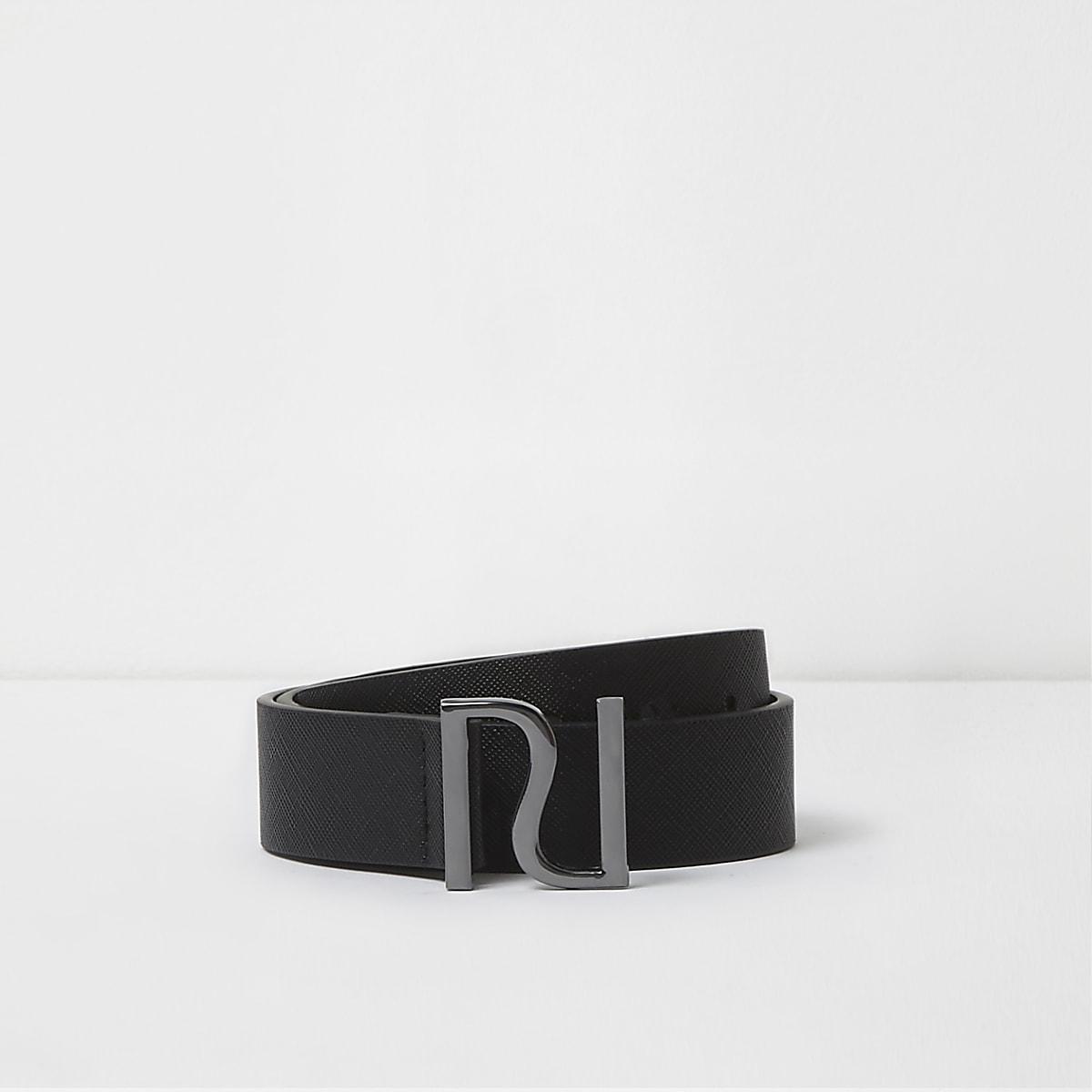 Schwarzer Gürtel mit RI-Pin
