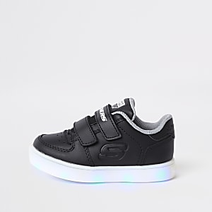 Mini boys Skechers black light-up trainers