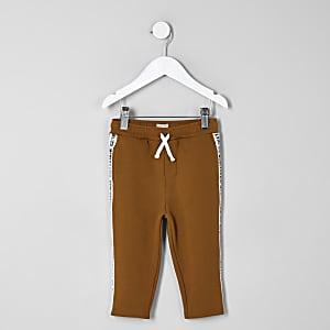 Mini - Oranje joggingbroek met bies voor jongens