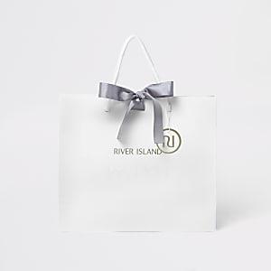 Witte mini-cadeautas met RI-logo voor kinderen