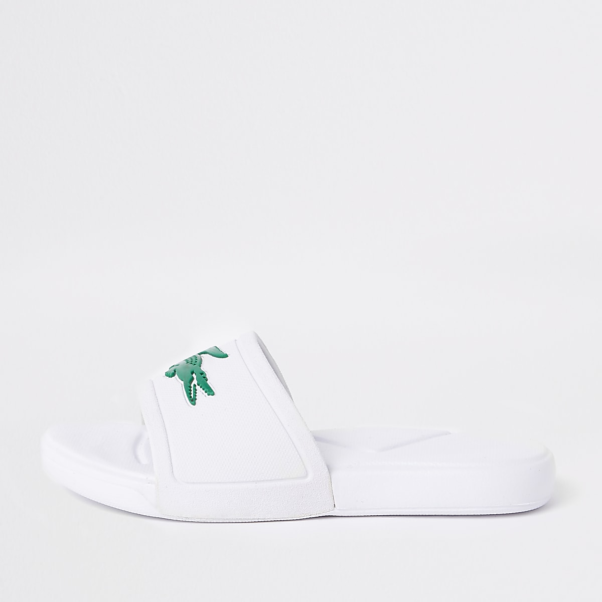 Boys Lacoste white embossed sliders