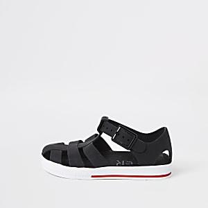 Sandales en plastique noires effet cage pour mini garçon