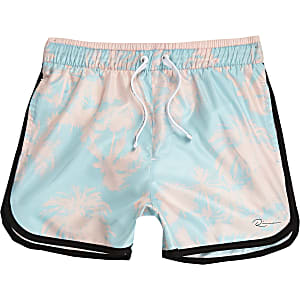 Boys blue palm print swim trunks