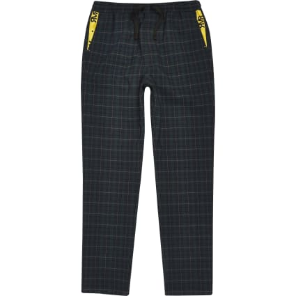 Boys green check trousers
