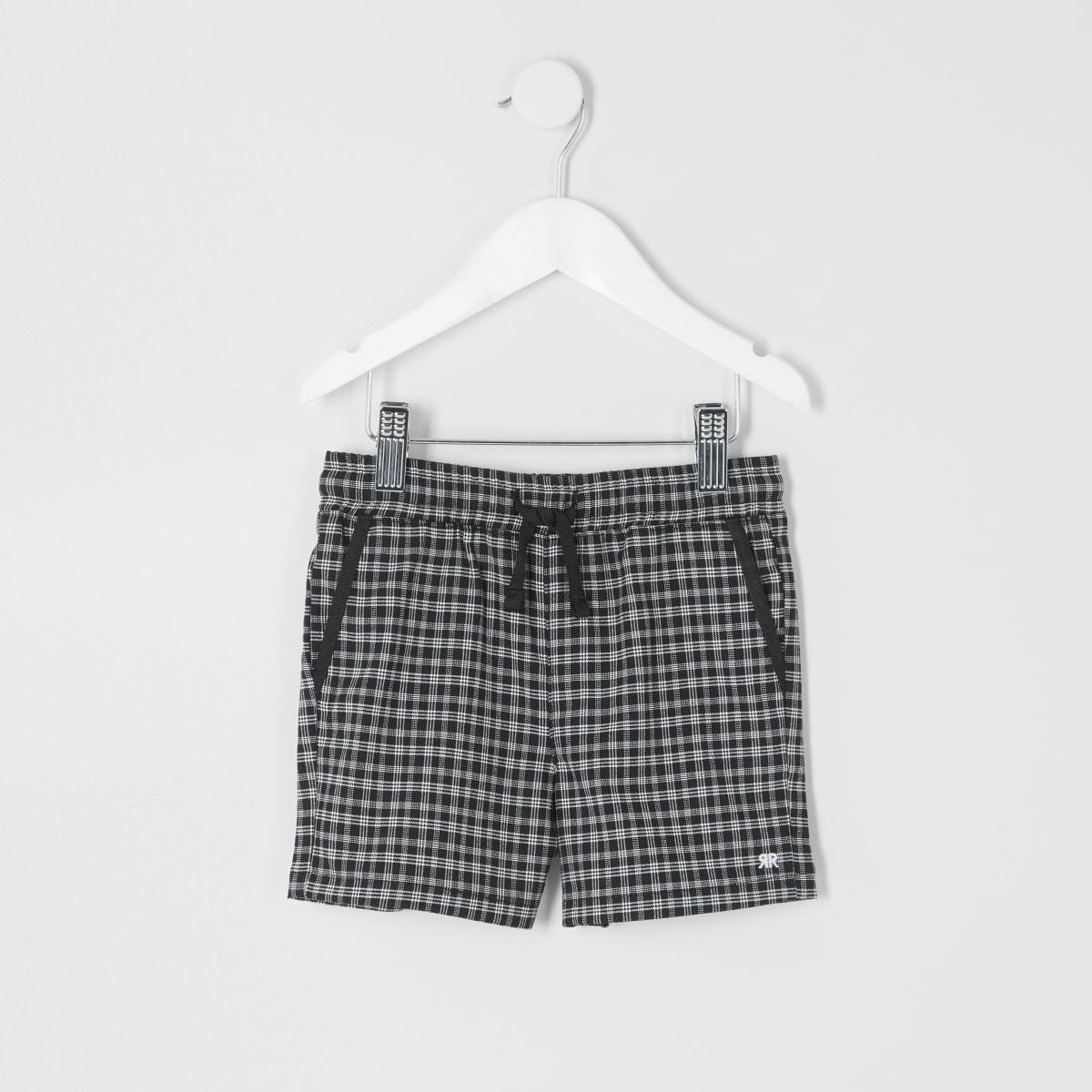Mini boys black check shorts