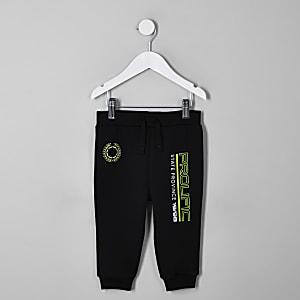 Pantalon de jogging noir à imprimé «Prolific» fluo mini garçon