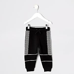 Mini - Zwarte joggingbroek met bies met RI-logo voor jongens
