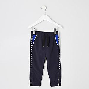 Pantalon à bande latérale bleu marine mini garçon