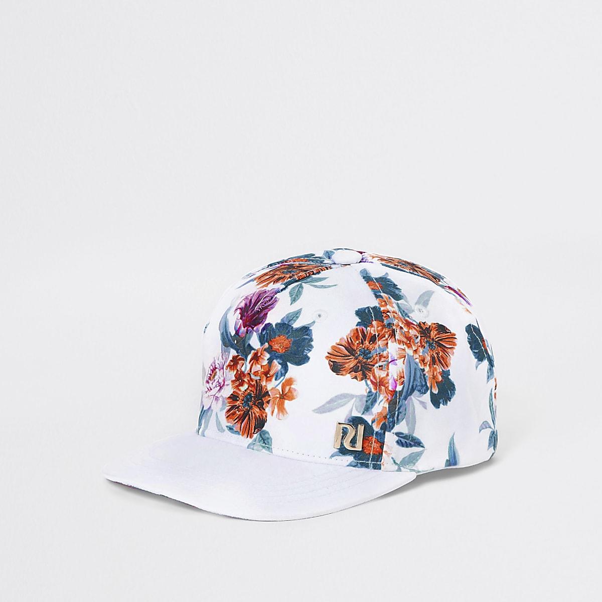 Weiße Kappe mit tropischem Motiv
