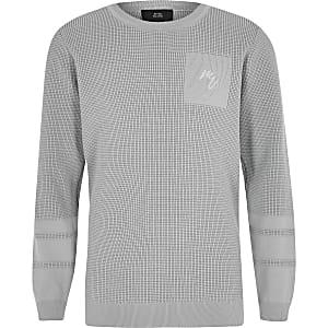 Grauer Pullover mit Struktur