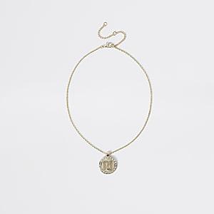 Goudkleurige ketting met cirkelvormige hanger met RI-letters voor meisjes