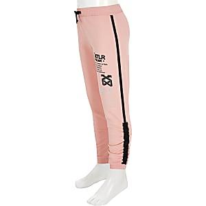 Koraalrode joggingbroek met ATLR-print voor meisjes