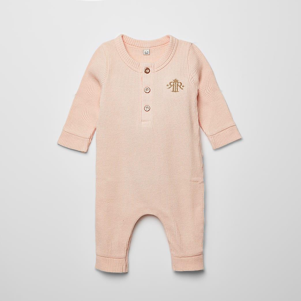 Roze baby-grow rompertje met wafeldessinvor baby's