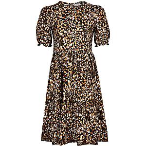Gesmoktes Kleid in Beige mit Leoprint für Mädchen