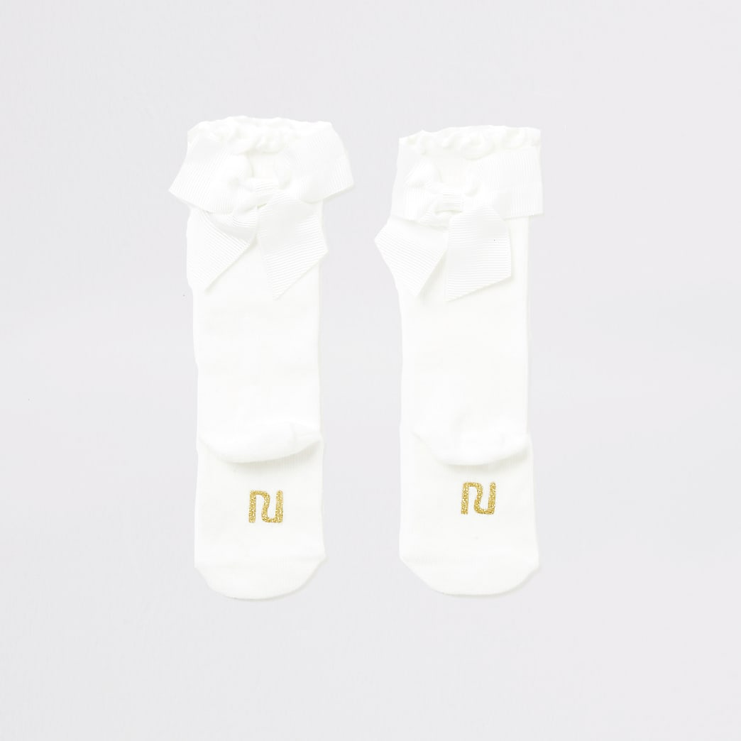 Baby cream knee high bow socks