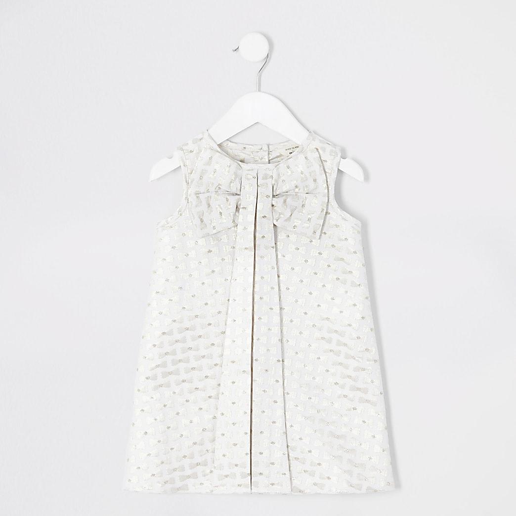 Mini - Crèmekleurige jurk met strik en reliëf voor meisjes