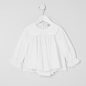 Weiße Bluse mit Rüschen am Ausschnitt für kleine Mädchen