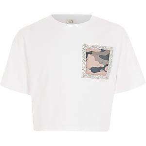 Wit T-shirt met zak met camouflageprint omringd door siersteentjes