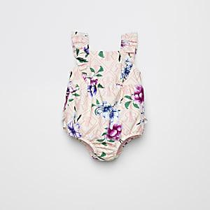 Roze zwempak met ruches en bloemenprint voor baby's