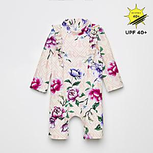 Roze alles-in-een zwempak met bloemenprint en zonbescherming voor baby's