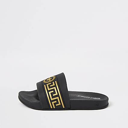 Boys black wasp crest embossed sliders