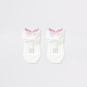 Chaussettes crèmeavec papillons ornés pour bébé