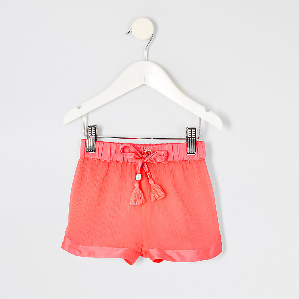 Mini girls neon pink sheer beach shorts