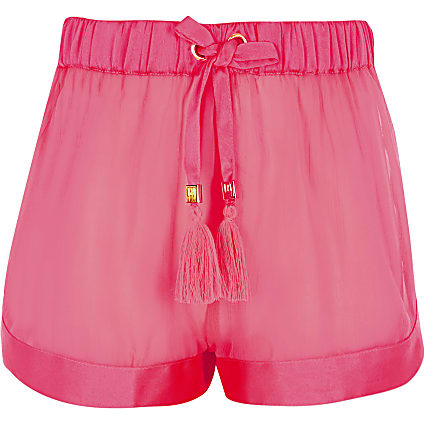 Girls neon pink sheer beach shorts