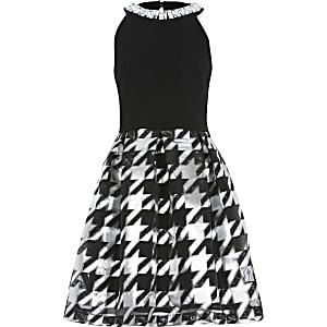 Zwarte jurk met rok met pied-de-poule-motief en siersteentjes bij de hals voor meisjes